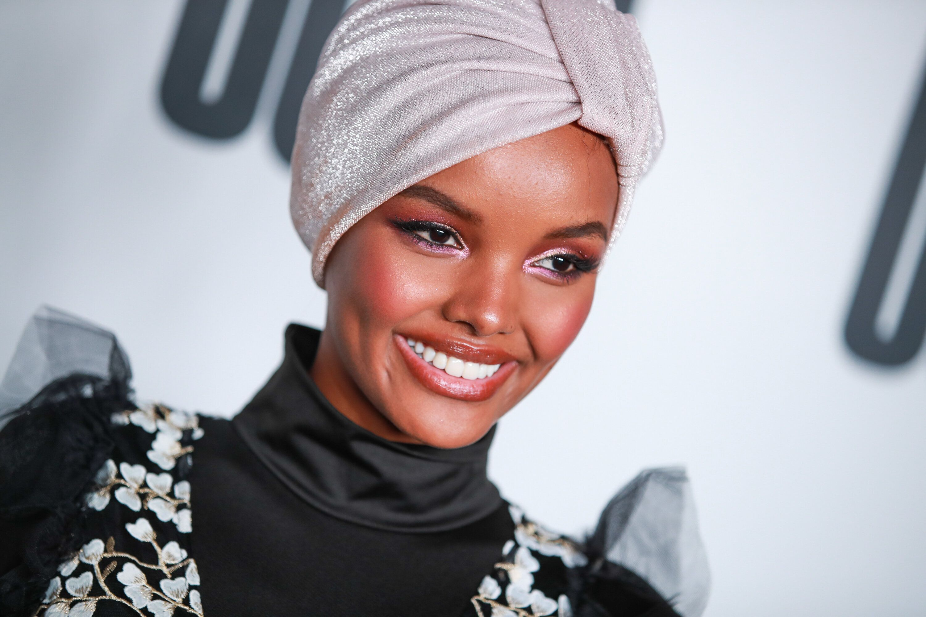 """LOS ANGELES, CALIFORNIA - APRIL 25: Halima Aden attends House Of Uoma presents the launch of Uoma Beauty - The World's First """"Afropolitan"""" Makeup Brand at NeueHouse Hollywood on April 25, 2019 in Los Angeles, California. (Photo by Rich Fury/Getty Images)"""