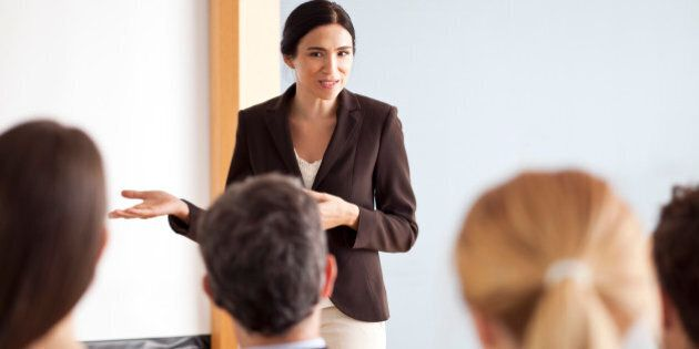 Businesswoman giving presentation at
