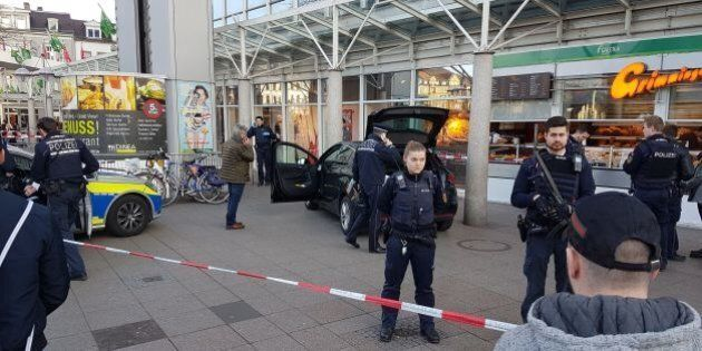 Policemen stand around a car in front of a business building in Heidelberg, western Germany, where a...