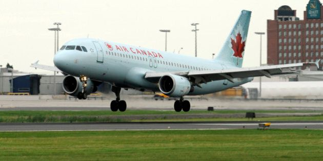 An Air Canada Airbus A320 - 200 lands on runway 24R at Pearson Airport this morning. TONY BOCK/TORONTO...
