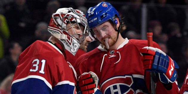 Dec 20, 2016; Montreal, Quebec, CAN; Montreal Canadiens goalie Carey Price (31) reacts with teammate...