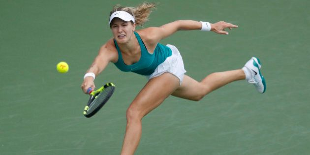 Eugenie Bouchard, of Canada, returns to Barbora Strycova, of the Czech Republic, at the Western & Southern...