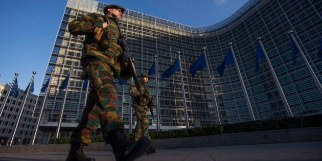 Belgian soldiers patrol outside the European Commission headquarters in central Brussels January 17,...