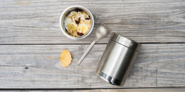 Breakfast to go outdoor style in an insulated mug. Fresh bananas, yogurt, and