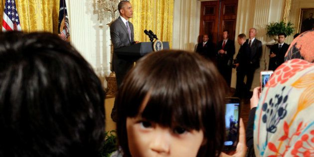 Sophia Ahmadinejad, 2-year-old, a refugee from Afghanistan listens as U.S. President Barack Obama delivers...