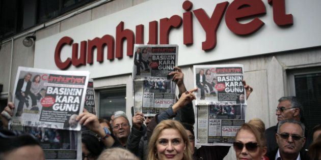 People gather to protest the jailing of opposition Cumhuriyet newspaper's editor-in-chief Can Dundar...