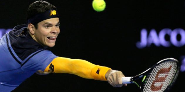 Milos Raonic of Canada hits a backhand return to Gael Monfils of France during their quarterfinal match...