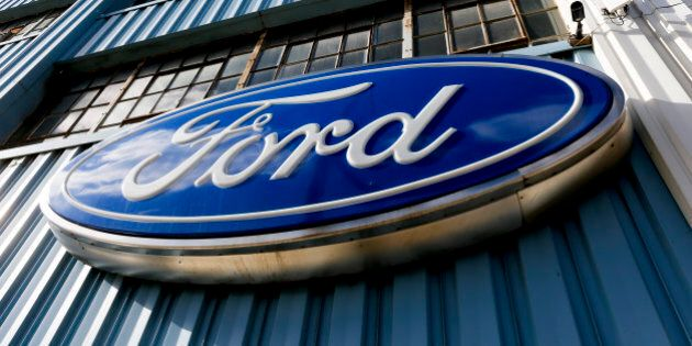 This Thursday, Nov. 19, 2015, photo, shows a blue oval Ford sign above the entrance to Butler County Ford in Butler, Pa. Ford announced Tuesday, Jan. 26, 2016, that the company is recalling nearly 391,000 Ranger pickups because the driver's air bag inflators can explode with too much force and cause injuries. The recall covers trucks from 2004 through 2006 in the U.S. and Canada. (AP Photo/Keith Srakocic)