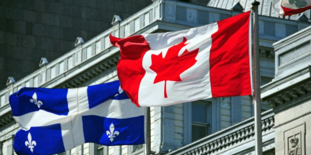 Montreal, Quebec, Canada: Canadian and Quebecer flags in front of the old Palace of Justice - Vieux palais...