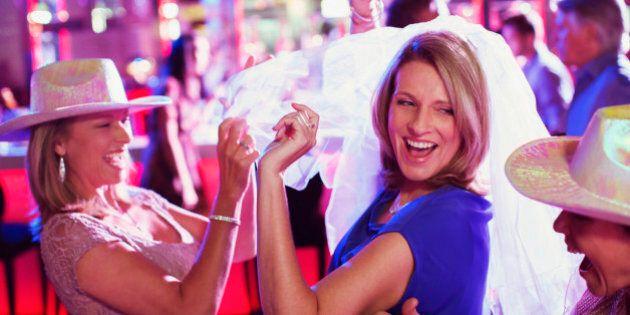 Women wearing hats dancing at bachelorette