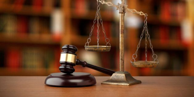 Gavel And Scales Of Justice On Desk In Law