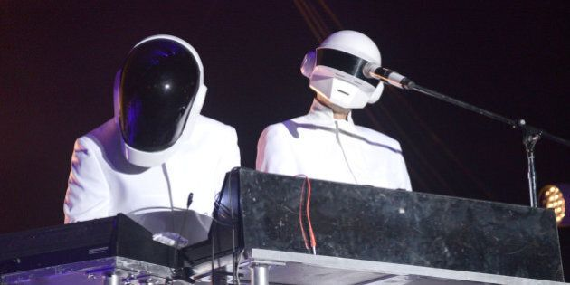 INDIO, CA - APRIL 20: Guests dressed as Daft Punk perform with Arcade Fire live onstage to close out...