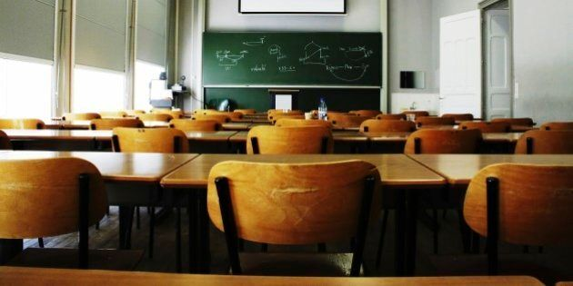 A large, empty classroom, lit by morning