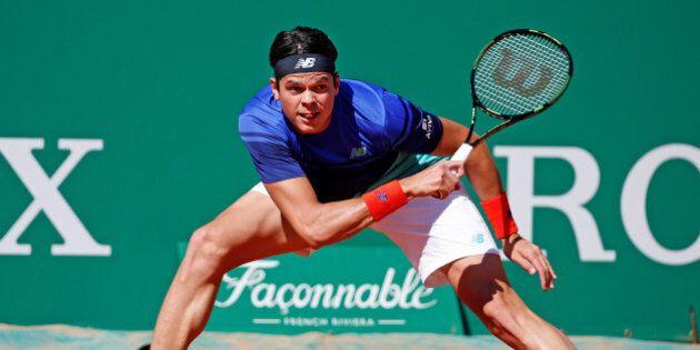 Tennis - Monte Carlo Masters - Monaco, 14/04/2016. Milos Raonic of Canada plays a shot to Damir Dzumhur...