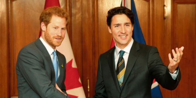 Britain's Prince Harry (L) is greeted by Canada's Prime Minister Justin Trudeau during a promotion for...