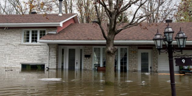 The flooded home of Mina Tayarani, who was evacuated after water levels passed the basement and reached over a foot on the main floor, is seen in a flooded residential neighbourhood in Ile Bizard, Quebec, Canada May 8, 2017. REUTERS/Christinne Muschi