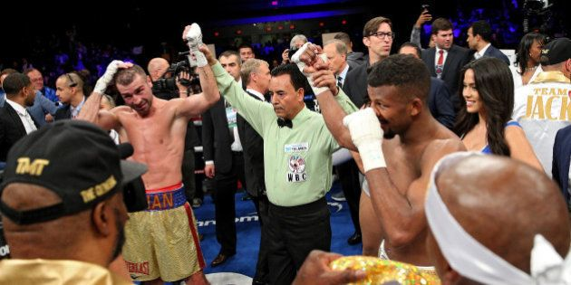 WASHINGTON, DC - APRIL 30: Lucian Bute of Canada (left) and Badou Jack of Sweden react after a draw was...
