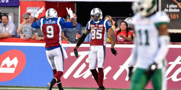 MONTREAL, QC - JUNE 22: Wide receiver B.J. Cunningham #85 of the Montreal Alouettes celebrates his touchdown with teammate wide receiver Ernest Jackson #9 against the Saskatchewan Roughriders in the first half during the CFL game at Percival Molson Stadium on June 22, 2017 in Montreal, Quebec, Canada. (Photo by Minas Panagiotakis/Getty Images)