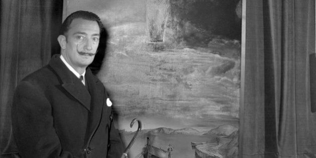 Spanish surrealist painter, Salvador Dali, with his painting 'Christ of Saint John of the