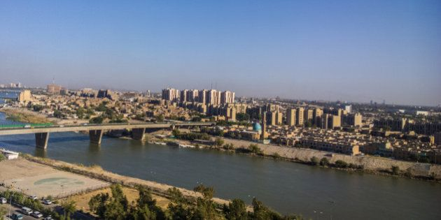 Aerial photographs of the city of Baghdad ,And shows where residential complexes and the Tigris River...