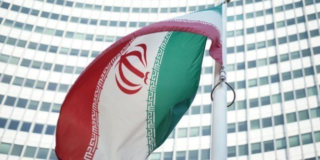 An Iranian flag waves in a wind outside the Vienna International Centre hosting the United Nations (UN)...