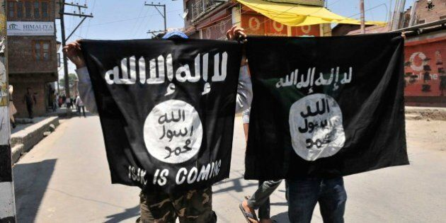 SRINAGAR, INDIA - JUNE 27: Kashmiri protesters displaying the flags of ISIS during a protest against...