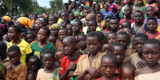 In this photo taken on Tuesday, Dec. 29 2015, Burundian refugees attend a rally addressed by Tanzania...