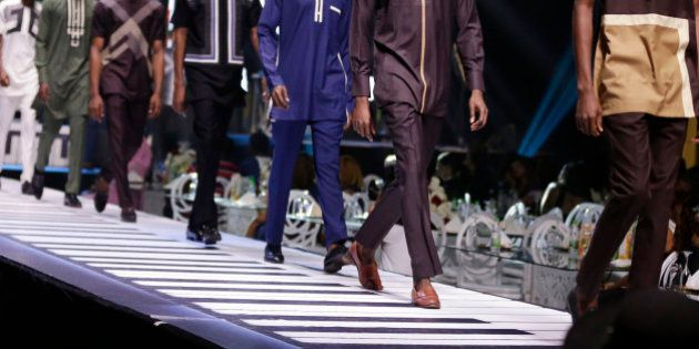Models show an outfit by designer VANSKERE during the Music Meets Runway fashion show in Lagos, Nigeria,...