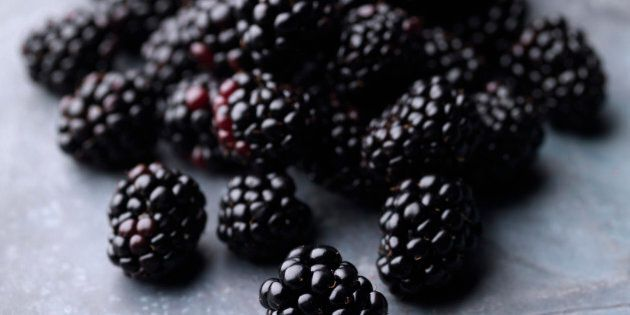 A pile of fresh blackberries on a steel