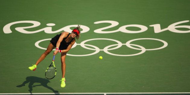RIO DE JANEIRO, BRAZIL - AUGUST 08:  Eugenie Bouchard of Canada serves during the Women's Singles second round match against Angelique Kerber of Germany on Day 3 of the Rio 2016 Olympic Games at the Olympic Tennis Centre on August 8, 2016 in Rio de Janeiro, Brazil.  (Photo by Clive Brunskill/Getty Images)