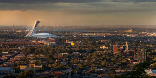 Color picture of the Olympic Stadium, viewed from the Mont-Royal, Montreal. Large shot. Photographed at the magic hour.