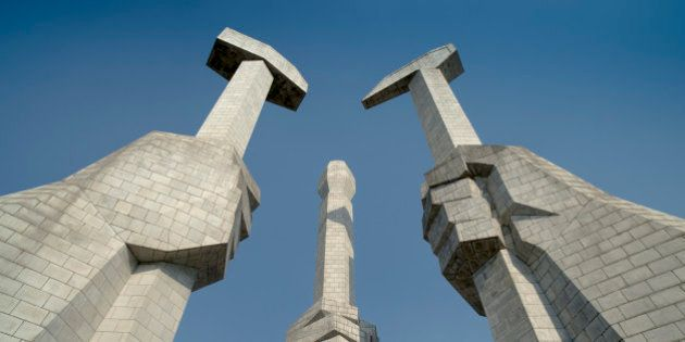 The Monument to the Korean Workers Party showing the hammer, sickle, and writer's brush in Pyongyang,...