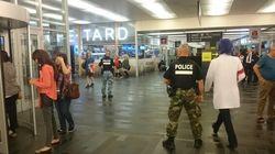 Homme armé à la station de métro