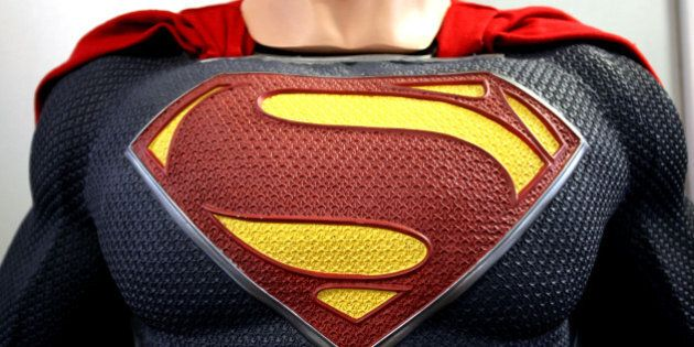 Man dressed in Superman costumes stand for a photo during Comicdom Con Festival, a three-day comics festival,...
