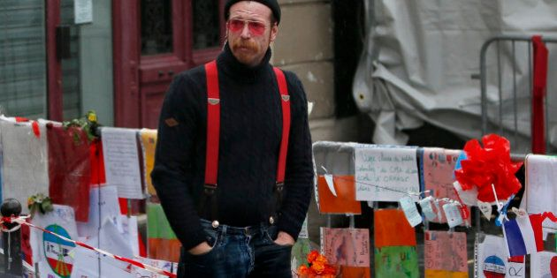 Jesse Hughes, member of Eagles of Death Metal band, mourns in front of the Bataclan concert hall to pay tribute to the shooting victims in Paris, France, December 8, 2015. The band Eagles of Death Metal, known as EODM, was performing at the Bataclan when the deadliest of the Islamic State attacks took place in Paris on November 13.     REUTERS/Charles Platiau