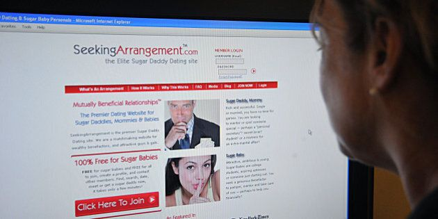 This August 9, 2011 photo shows a journalist reading the SeekingArrangement.com dating website in Washington,...