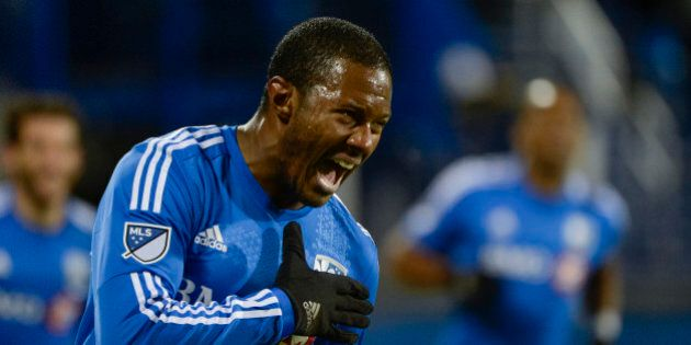 Oct 29, 2015; Montreal, Quebec, CAN; Montreal Impact midfielder Patrice Bernier (8) reacts after scoring...