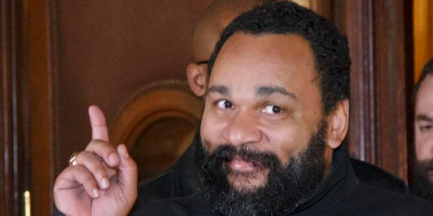 French comedian Dieudonne M'Bala M'Bala gestures to the media as he leaves a Paris court house, Wednesday,...