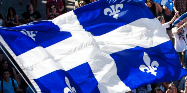A flag of Quebec is seen as thousands of demonstrators march against student tuition fee hikes in downtown...