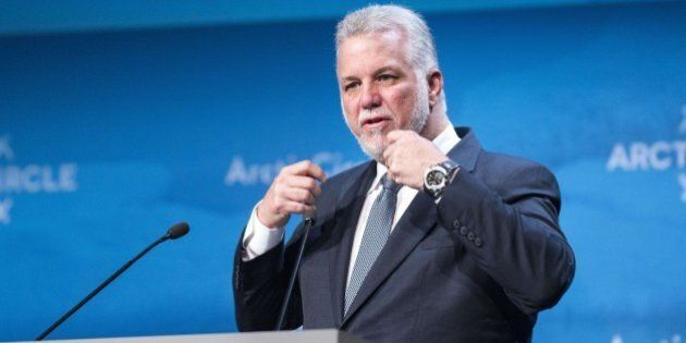 Quebec Premier Philippe Couillard delivers a speech during the opening plenary session of the Arctic...