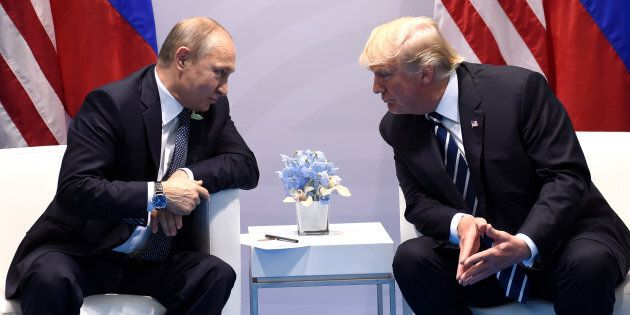 US President Donald Trump and Russia's President Vladimir Putin hold a meeting on the sidelines of the...