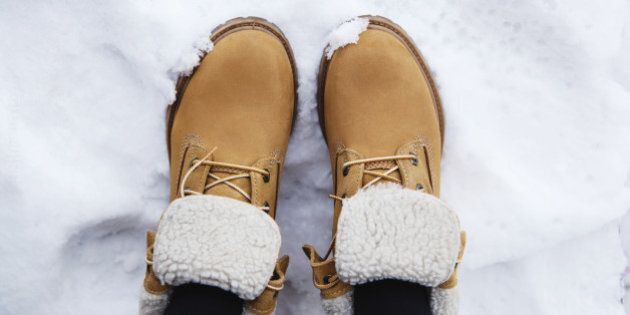 Pair brown boots in white fresh