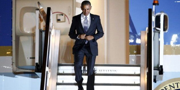 U.S. President Barack Obama walks down the steps of Air Force One as he arrives at Stansted Airport near...