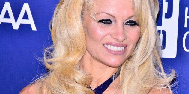 LOS ANGELES, CA - JANUARY 10: Pamela Anderson arrives at the 4th Annual Sean Penn & Friends 'Help Haiti...
