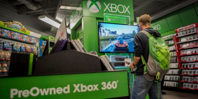 A customer plays a Microsoft Corp. Xbox 360 video game at a GameStop Corp. store in San Francisco, California,...