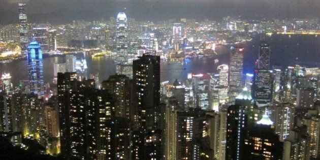 Hong Kong's skyline gleams from the top of Victoria Peak, a popular tourist destination on Hong Kong...