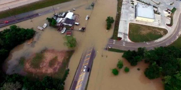 Flood waters cover the area of FM 1463 at IH-10 in Fort Bend County, Texas, U.S. April 19, 2016. Texas...