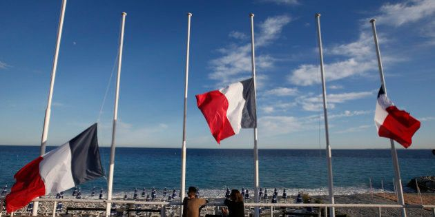 Flags fly at half-mast in memory of victims the day after a truck ran into a crowd at high speed killing scores and injuring more who were celebrating the Bastille Day national holiday, in Nice, France, July 15, 2016.    REUTERS/Eric Gaillard