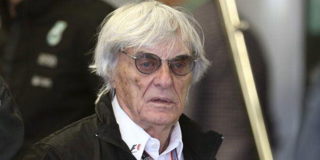Formula One supremo Bernie Ecclestone walks in the Mercedes team garage during the third practice session...