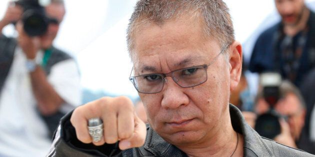 Director Takashi Miike poses during a photocall for the film